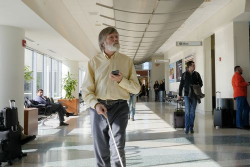 user walking through airport